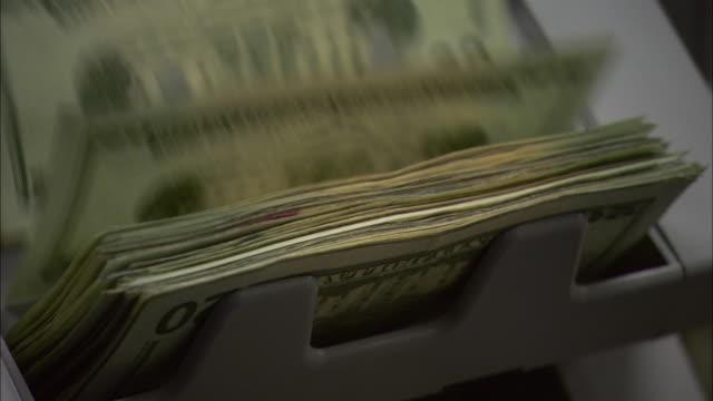 a cash machine counts twenty-dollar bills. - banknote stock videos & royalty-free footage