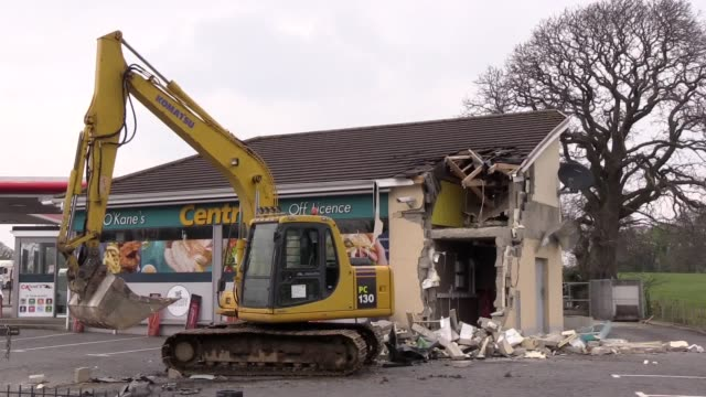 a cash machine has been ripped from a wall and stolen in northern ireland in the latest of a spate of atm thefts the raid in dungiven co londonderry... - baufahrzeug stock-videos und b-roll-filmmaterial