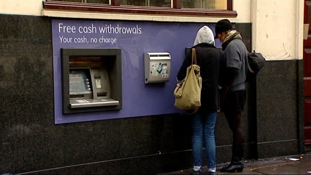 cash point outside sainsbury's local store national bank of kuwait sign national bank of abu dhabi sign nat west bank people using cash machines... - banking sign stock videos & royalty-free footage