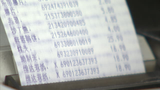 a cash register prints a receipt. - receipt stock videos & royalty-free footage