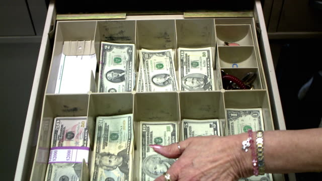 CU TU TD Cashier handling money, Bethlehem, Pennsylvania, USA