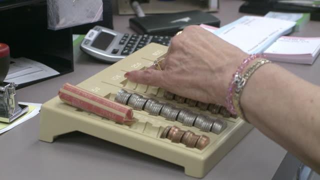 cu cashier handling money, bethlehem, pennsylvania, usa - financial accessory stock videos & royalty-free footage