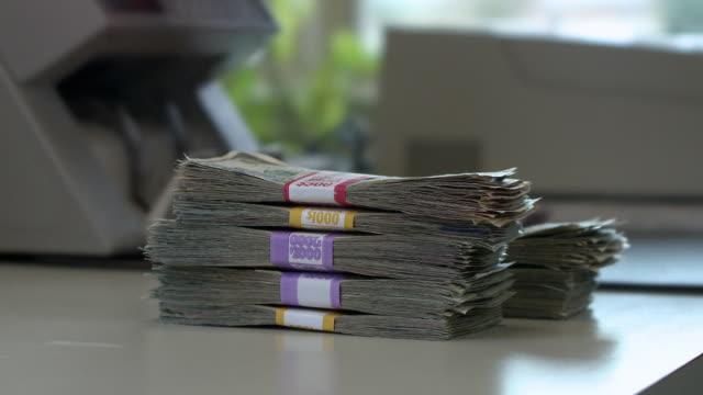 CU Cashier handling money using bill counting machine, Bethlehem, Pennsylvania, USA