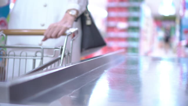 cashier scanning groceries at checkout counter - europe stock videos & royalty-free footage