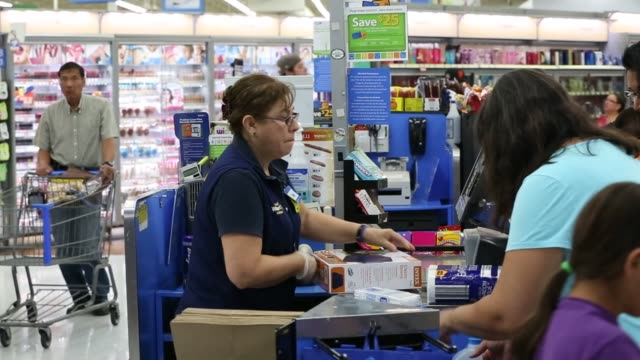 stockvideo's en b-roll-footage met a cashier scans school supplies for a customer at a walmart stores inc location in the porter ranch neighborhood of los angeles california us on... - wal mart