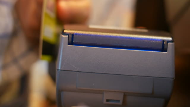 cashier using credit card reader