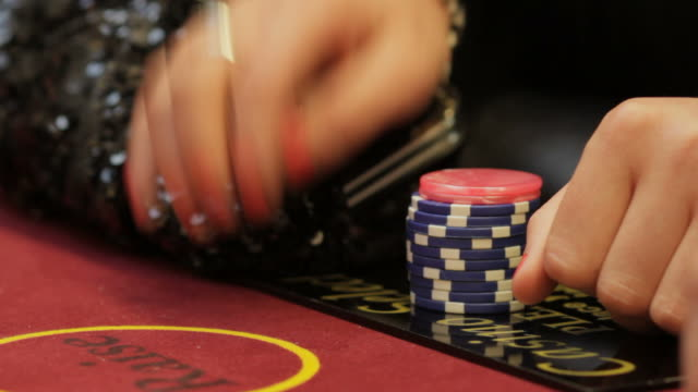 casino chips and hands placing bet - blackjack stock videos and b-roll footage