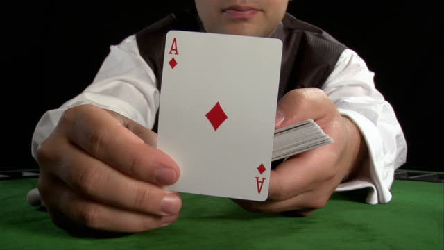 casino dealer showing ace of diamonds to camera - cards stock videos and b-roll footage