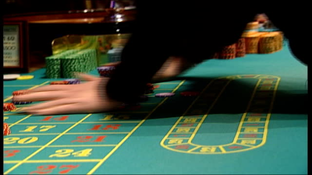 casino general views casino worker taking chips from stacks more of anonymous gamblers placing their chips on table more of croupier scopping chips... - casino worker stock videos and b-roll footage