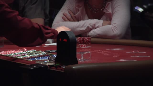 casino interiors / blackjack card game / gambling / no faces shown / dealer puts down queen and ace / gambler puts down chips las vegas blackjack on... - blackjack stock videos and b-roll footage