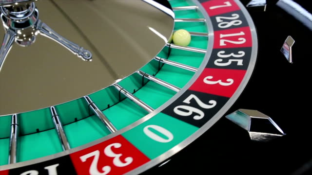 Casino roulette wheel with the ball on number 12