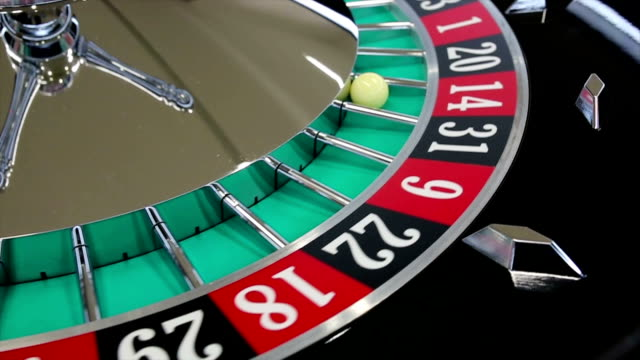 casino roulette wheel with the ball on number 14 - roulette wheel stock videos and b-roll footage