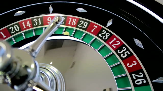 casino roulette wheel with the ball on number 18 - roulette wheel stock videos and b-roll footage
