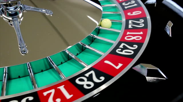 casino roulette wheel with the ball on number 22 - roulette stock videos and b-roll footage