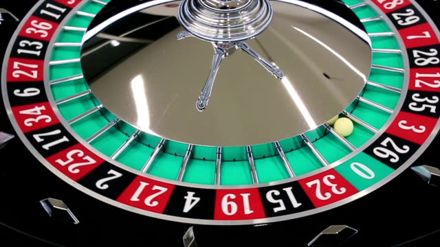 casino roulette wheel with the ball on number 26 - roulette wheel stock videos and b-roll footage