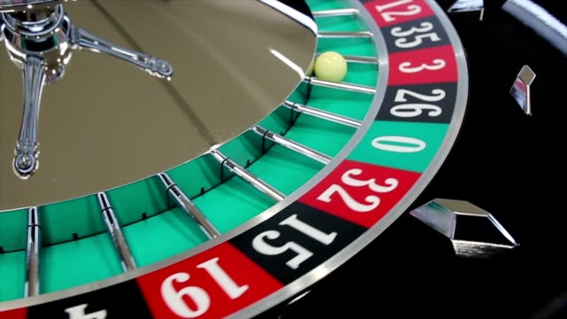 Casino roulette wheel with the ball on number 3