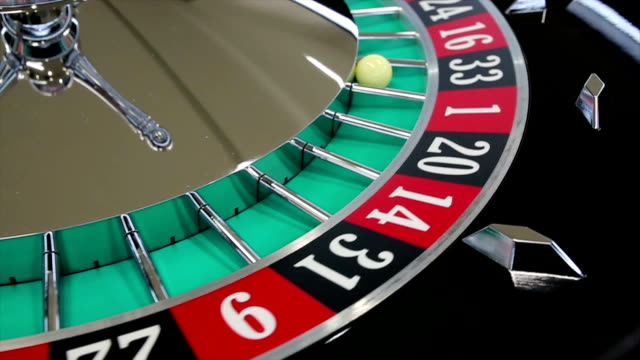 casino roulette wheel with the ball on number 33 - roulette stock videos and b-roll footage