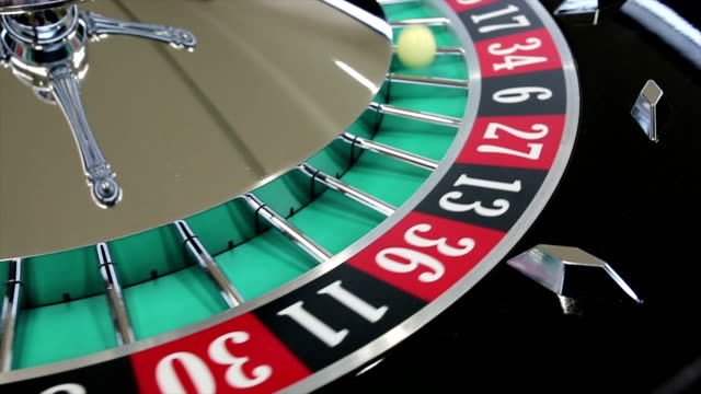 casino roulette wheel with the ball on number 34 - roulette stock videos & royalty-free footage