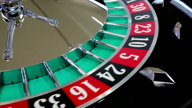 Casino roulette wheel with the ball on number 8
