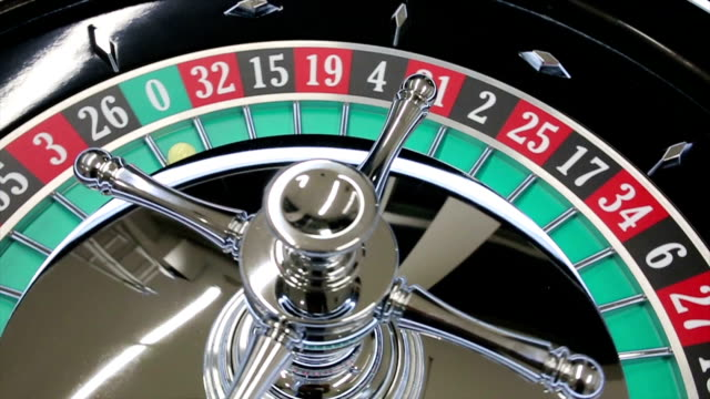 casino roulette wheel with the ball on number zero - roulette stock videos & royalty-free footage