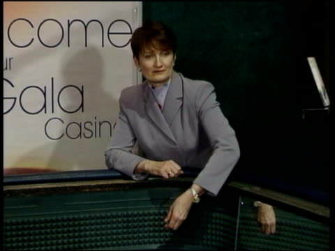 casino worker at gaming table t26030201 culture secretary tessa jowell mp throwing dice dice hitting table - casino worker stock videos and b-roll footage