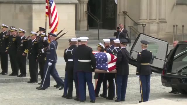 casket of former president george hw bush arriving at the national cathedral in washington where a state funeral is taking place for the 41st us... - bush stock videos & royalty-free footage