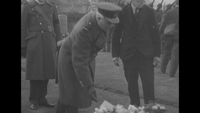 ms caskets carried into cemetery mourners to one side as uk and german dead are buried after attack on firth of forth / cu soldiers stand with heads... - german flag stock videos & royalty-free footage