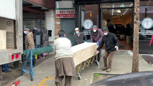 caskets of muslims who have passed away from the coronavirus are prepared for burial at a busy brooklyn funeral home on the first day of ramadan on... - brooklyn new york stock videos & royalty-free footage