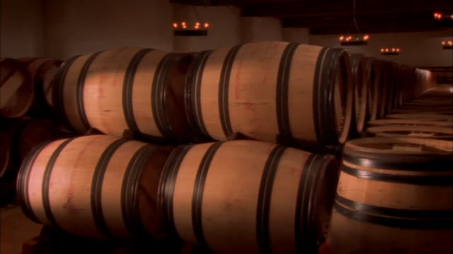 Casks of wine stacked in cellar at Chateau Haut-Brion / Pessac, Graves, France