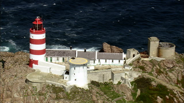 casquets lighthouse - aerial view - helicopter filming,  aerial video,  cineflex,  establishing shot,  guernsey - channel islands england stock videos & royalty-free footage