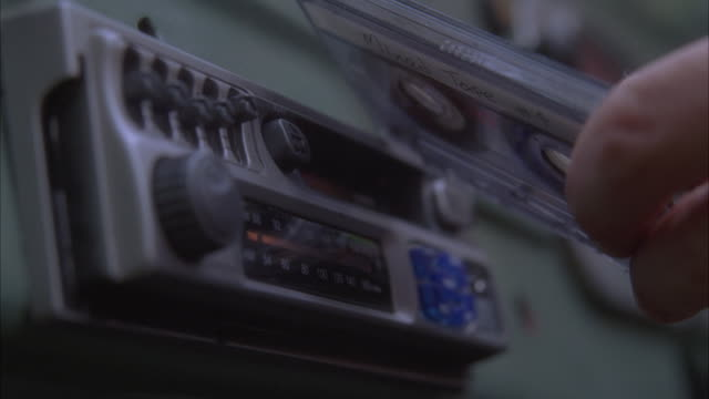 stockvideo's en b-roll-footage met a cassette tape is rejected and reinserted several times. - cassettebandje