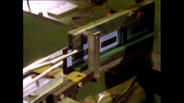 cassette tapes being made on a production line; 1986 - analog stock videos & royalty-free footage