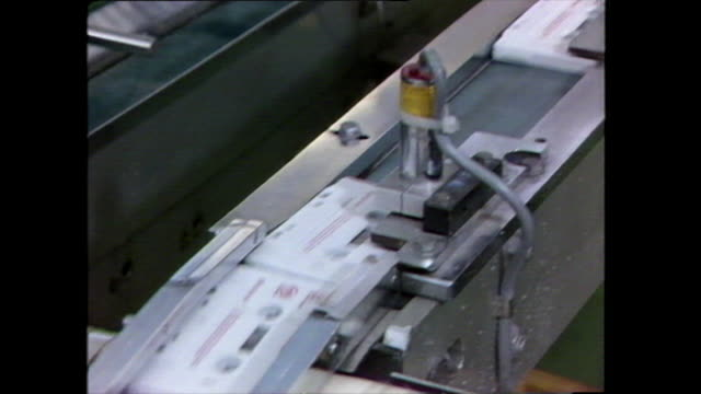 cassettes tapes being made on a production line; 1983 - automatic stock videos & royalty-free footage