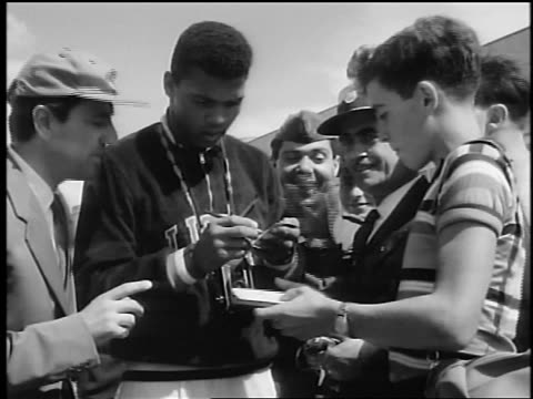 cassius clay signing autographs for men + boy / rome, italy / documentary - 1960 stock videos & royalty-free footage