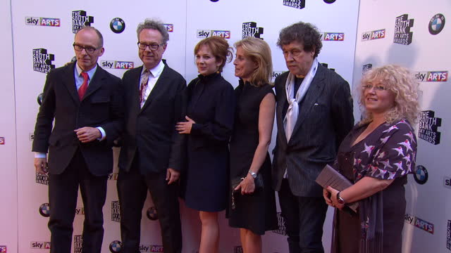 Cast and crew of 'The Honourable Woman' arrive and pose for pics including Hugo Blick Greg Brenman Katherine Parkinson guest Stephen Rea and Abi Bach...