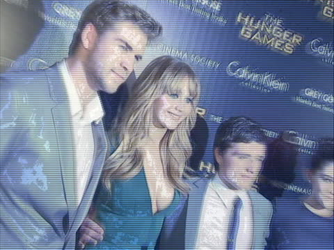 cast and producers of the hunger games posing on the red carpet premiere in new york city. the hunger games is a 2012 american dystopian science... - science fiction film stock videos & royalty-free footage