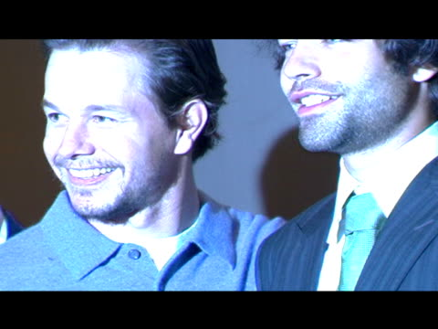 cast of entourage posing for paparazzi in theater: mark wahlberg takes place between jeremy piven & adrian grenier; doug ellin joins the guys & takes... - jeremy piven stock videos & royalty-free footage