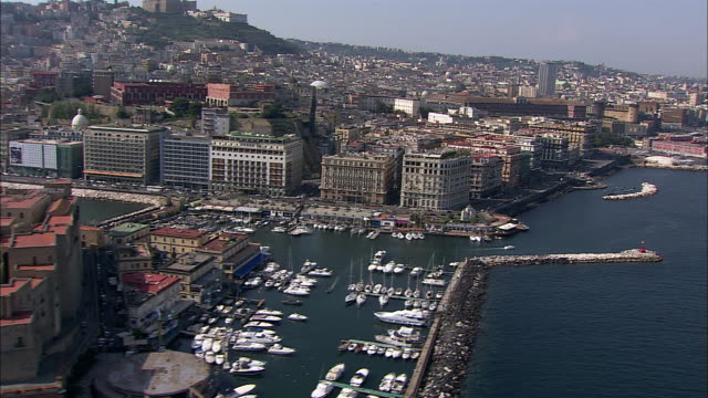 castel dell'ovo, palazzo reale and castel nuovo serve as prominent landmarks in naples, italy. - ナポリ点の映像素材/bロール