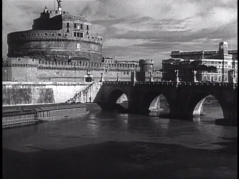 ws castel sant'angelo bridge over tiber river people walking on sant'angelo bridge horsedrawn open carriage on roadway now houses museo nazionale di... - mausoleum stock videos and b-roll footage