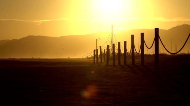 castelldefels beach sunset - barcelona - picket fence stock videos and b-roll footage