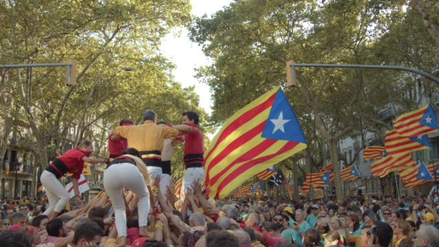 castellers at catalonia demonstration movement for the independence from spain. barcelona during 11 september 2019 at barcelona. catalan national day - referendum stock videos & royalty-free footage