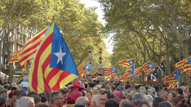 castellers at catalonia demonstration movement for the independence from spain. barcelona during 11 september 2018, catalan national day - referendum stock videos & royalty-free footage