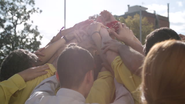 castellers building fundations for human pyramid - pyramid stock videos and b-roll footage