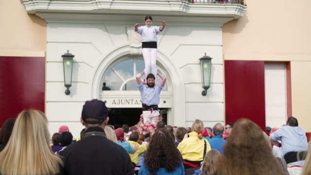 castellers celebrating a successful human pyramid - human pyramid stock videos and b-roll footage
