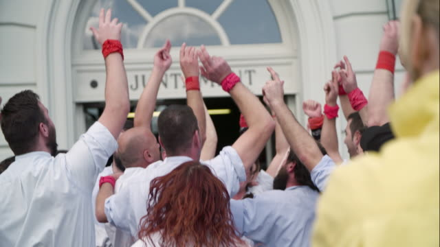 castellers celebrating after human pyramid - human pyramid stock videos and b-roll footage