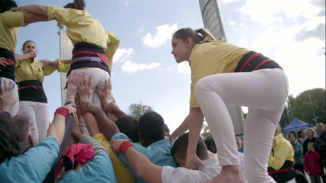 castellers human pyramid teamwork from catalonia - human pyramid stock videos and b-roll footage