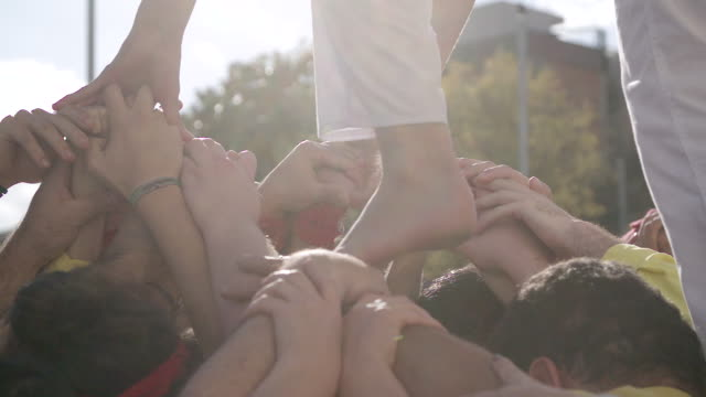 castellers human pyramid teamwork from catalonia - reggere video stock e b–roll