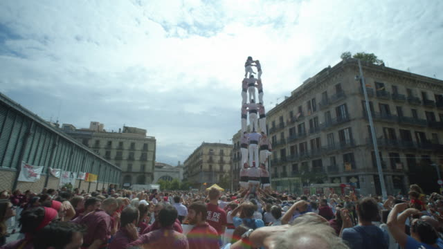 castellers human tower teamwork from catalonia at barcelona born district - 安定点の映像素材/bロール