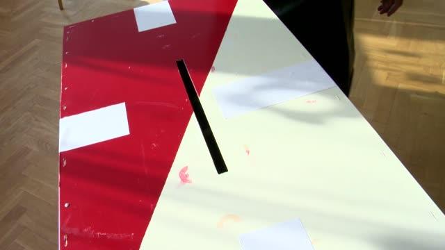 casting vote into ballot box - ballot slip stock videos & royalty-free footage