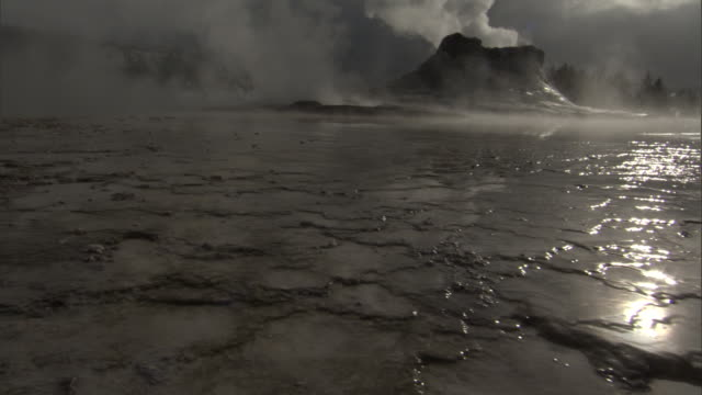 castle geyser ejects hot steam, yellowstone, usa - geyser stock videos & royalty-free footage